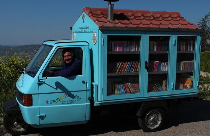 Retired Teacher Shares books through his Self-Made Mobile Library